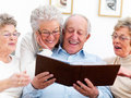 Group of happy elderly people looking at photos Royalty Free Stock Photos