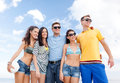 Group of happy friends with beach ball Royalty Free Stock Photo