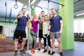 Group of happy friends in gym Royalty Free Stock Photo