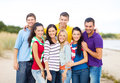 Group of happy friends hugging on beach summer holidays vacation tourism travel and people concept having fun and Royalty Free Stock Photography