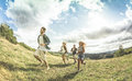 Group of happy friends running free at camping axperience Royalty Free Stock Photo