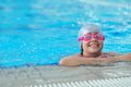 Group of happy kids children at swimming pool class learning to swim Stock Images