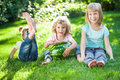 Group happy kids watermelon playing green grass summer park Royalty Free Stock Image