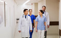 Group of happy medics or doctors at hospital Royalty Free Stock Photo