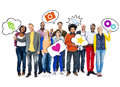 Group of happy multi ethnic people holding speech bubbles with symbols relating to social network Royalty Free Stock Photography