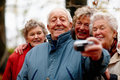 Group of happy older people taking a self portrait Royalty Free Stock Photos