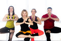 Group of happy people doing yoga training in class Royalty Free Stock Photo