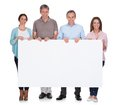 Group of happy people holding placard over white background Royalty Free Stock Images