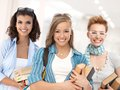 Group of happy student girls on school corridor looking at camera smiling Royalty Free Stock Photography