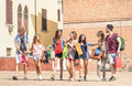 Group of happy students best friends with shopping bags Royalty Free Stock Photo