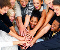 Group of happy students showing teamwork Stock Image
