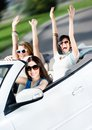 Group of happy teenagers in the white car Royalty Free Stock Photos