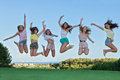 Group of happy teens jumping, Royalty Free Stock Photo