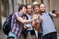 Group of happy tourist doing selfie Royalty Free Stock Photo