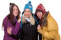 Group of happy women in winter with gloves scarf and caps isolated on a white background Royalty Free Stock Photos