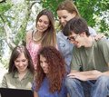 Group of happy young college students with laptop Royalty Free Stock Photo