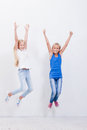 Group of happy young girls jumping  on white Royalty Free Stock Photo