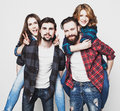 Group of happy young men and women emotional happiness people concept people giving piggybacks over white background special Stock Image