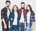 Group of happy young men and women life style happiness people concept attractive hipster style studio shot over white Stock Images
