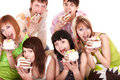 Group of happy young people with cake. Royalty Free Stock Photo