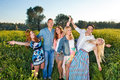 Group of happy young people posing in rapeseed Royalty Free Stock Photo