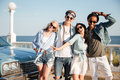 Group of happy young people standing on promenade Royalty Free Stock Photo