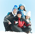 Group of happy young people in winter student warm clothing on snow at outdoors Stock Images