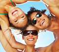 Group of happy young teenagers in circle at beach Royalty Free Stock Photography
