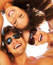 Group of happy young teenagers in circle at beach Royalty Free Stock Images