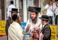 A group of Hasidim pilgrims in traditional clothing emotionally talk. Rosh hashanah holiday, Jewish New Year.