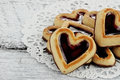Group of heart shaped shortbread cookies in a circle on a rustic background Royalty Free Stock Image