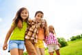Group of hugging years kids standing and in the park on summer day Stock Photo