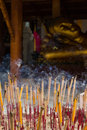 Group incense with candle and statue background religion concept Royalty Free Stock Photo