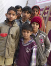Group of indian children gelawas india december posing self photo i n festival sowing seed Stock Photo