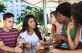 Group of international young adults in discussion in restaurant Royalty Free Stock Photo