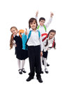 Group of kids with backpacks returning to school after vacation happy summer Royalty Free Stock Photography