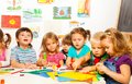 Group of kids on creative class little painting with pencils and gluing with glue stick art in kindergarten Royalty Free Stock Photos