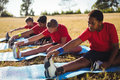 Group of kids exercising in the boot camp Royalty Free Stock Photo