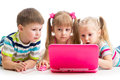 Group of kids friends at the laptop looking Royalty Free Stock Images
