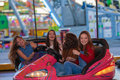 Group of kids at funfair or fairground on ride Stock Image