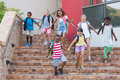 Group of kids getting down from staircase at school Royalty Free Stock Images
