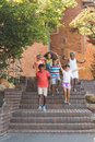 Group of kids getting down from staircase at school Royalty Free Stock Photography