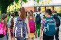 Group of kids going to school together. Royalty Free Stock Photo