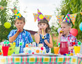Group of kids having fun at birthday party adorable Royalty Free Stock Photos