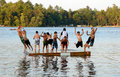 Group of kids jump into Lake Royalty Free Stock Images