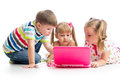 Group of kids looking at the laptop friends Royalty Free Stock Photography