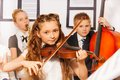 Group of kids playing musical instruments together Royalty Free Stock Photo