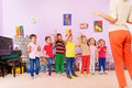 Group of kids repeating exercise after teacher Royalty Free Stock Photo
