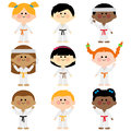 Group of kids wearing martial arts uniforms Royalty Free Stock Photo