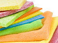 Group of kitchen sponges brightly colored on white background with copy space Stock Photos